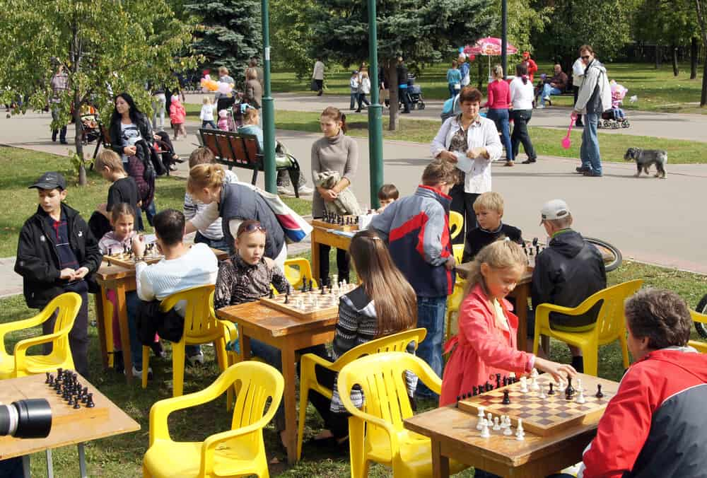 Children play chess. City Day celebrations in Moscow