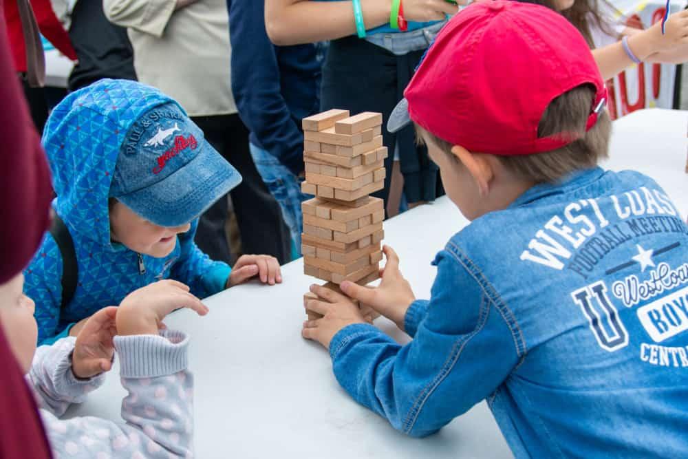 Children play jenga outdoors