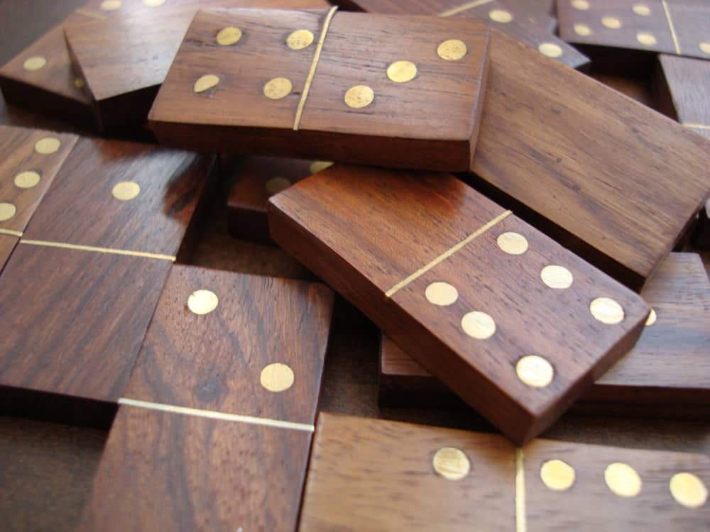 Dominoes are made of wood with metal parts