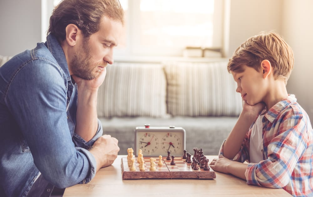 Father and son are playing chess