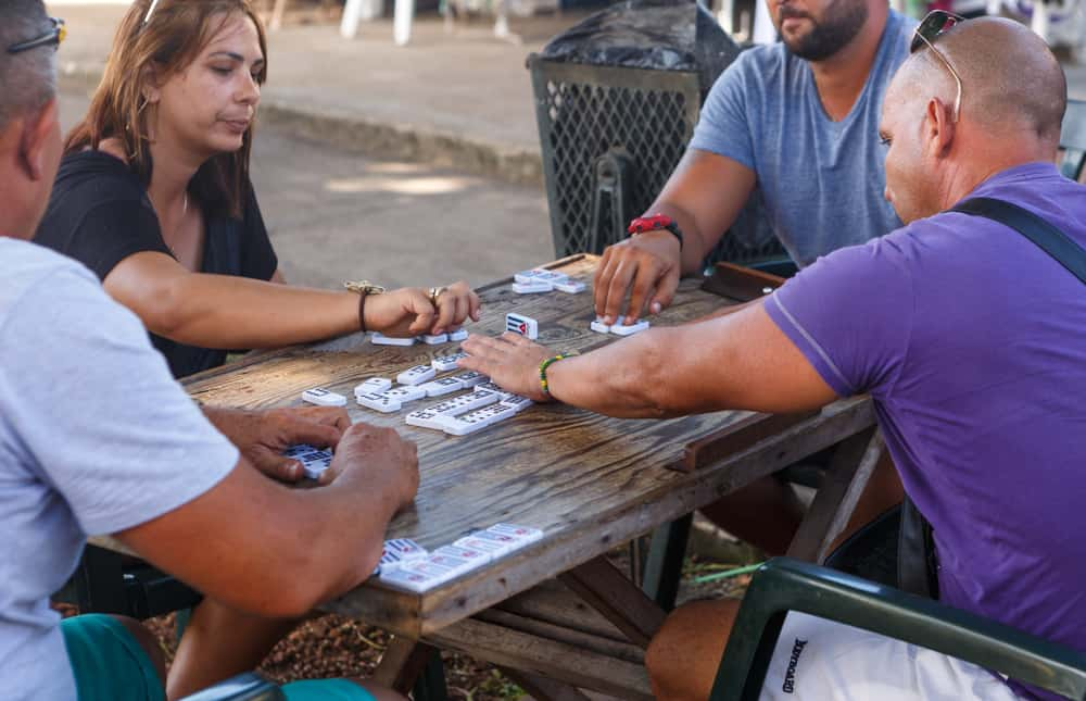 Local Cubans enjoying the popular game of dominoes