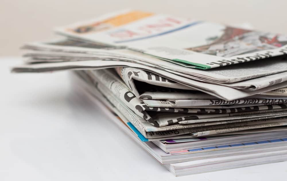 Magazines and newspapers on white table sudoku