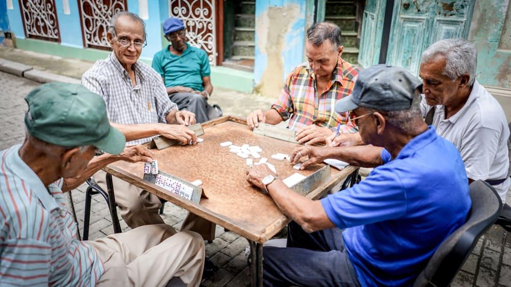 Old friends make Dominos play on the Havana street
