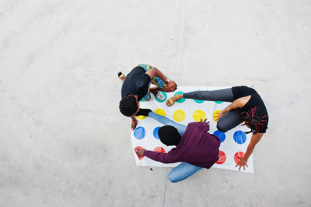 american friends play twister game outdoor