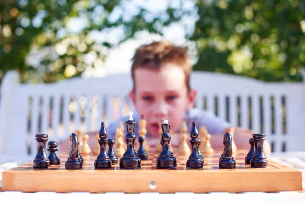 boy thinking over chess game