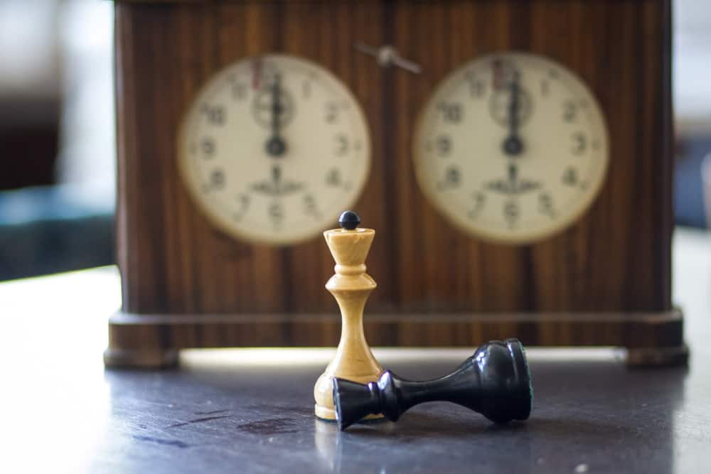 chess pieces with clock
