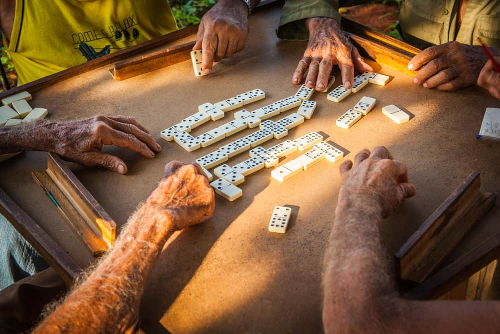 elderly farmers playing dominoes in the country around Vinales, Cuba