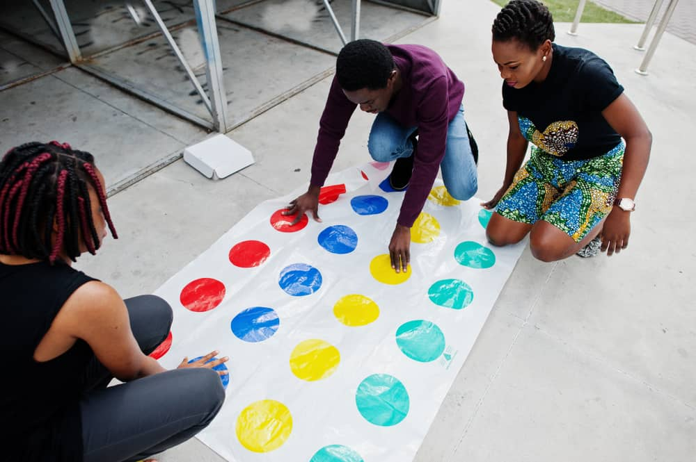 friends play twister game outdoor
