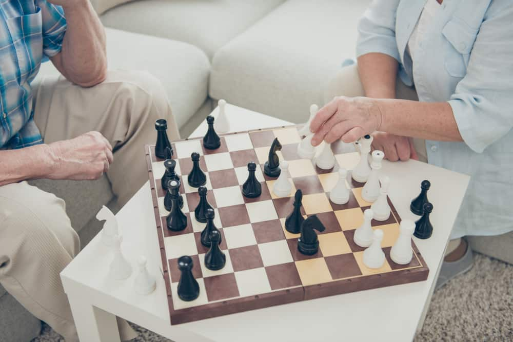 intelligent people playing chess creating move strategy