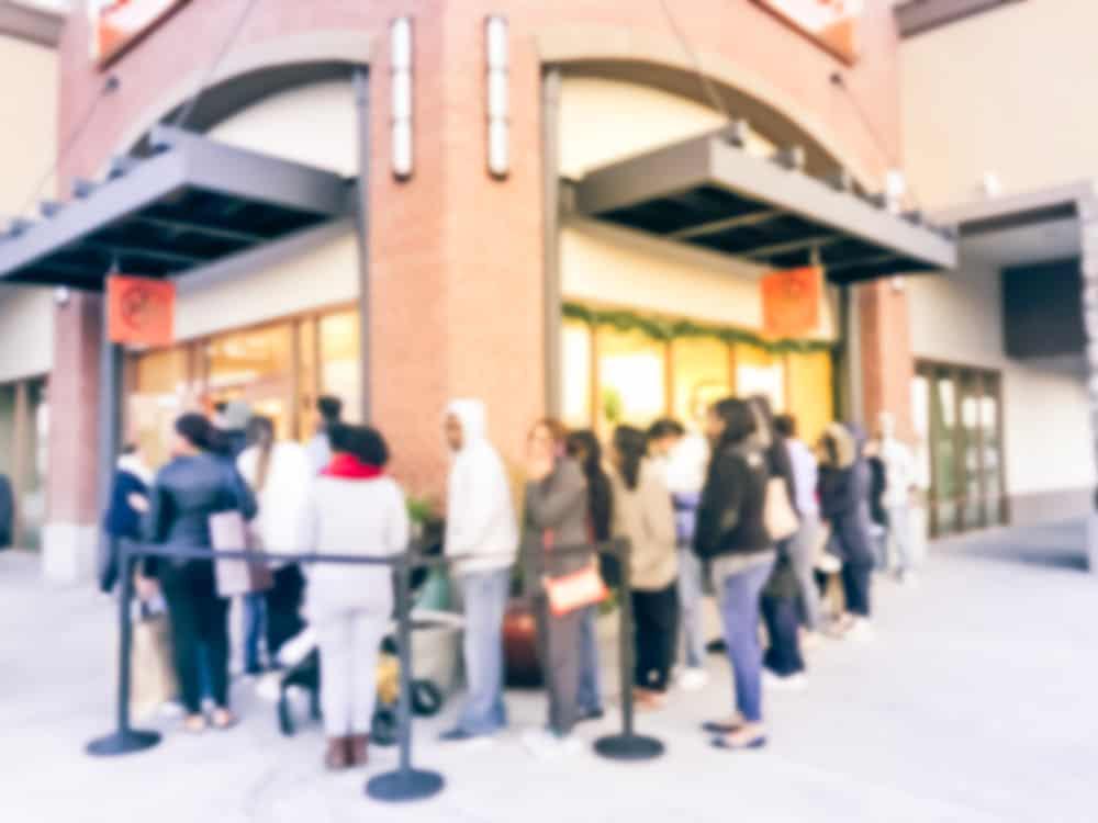 long line of customer waiting at entrance twister