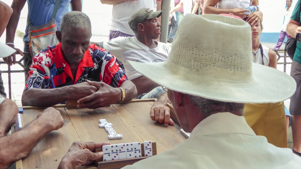 men playing a game of dominoes in the street of Old Havana
