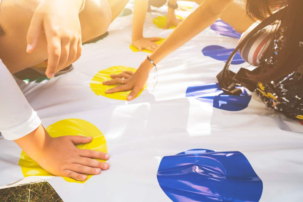 play a twister on the grass. Hands on yellow