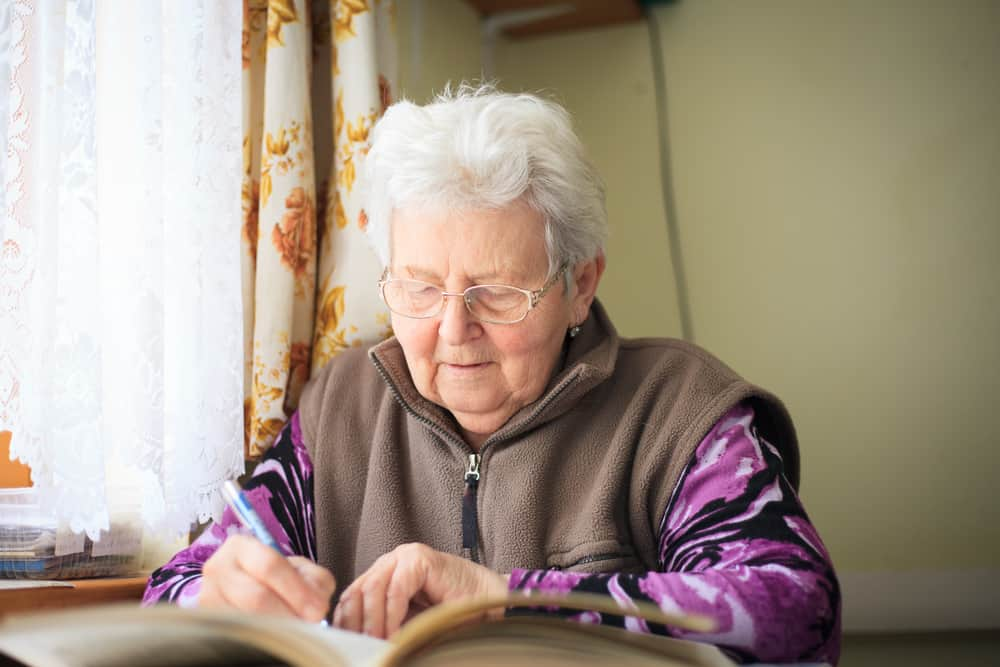 senior woman lusting a sudoku