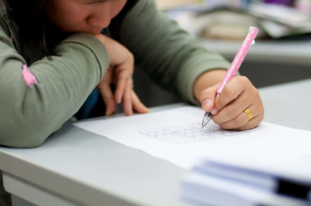 woman solving sudoku problem