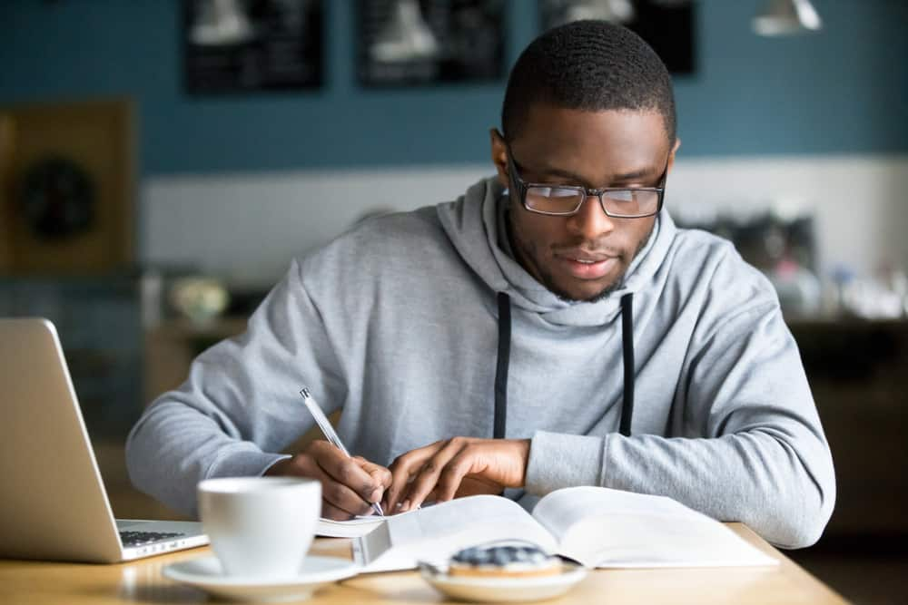 Focused millennial african american student poker