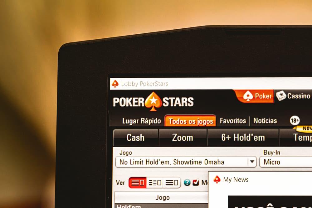 Pokerstars software open on a notebook