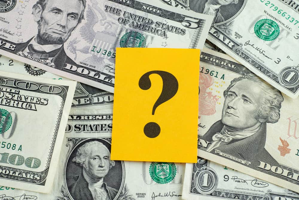 Question mark on dollar banknotes poker