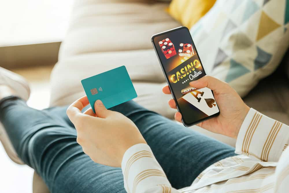 woman going to play online casino from the couch