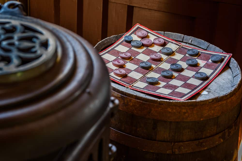 Antique vintage checker board game waiting to be played.