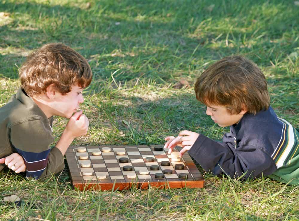 Boys Playing Checkers