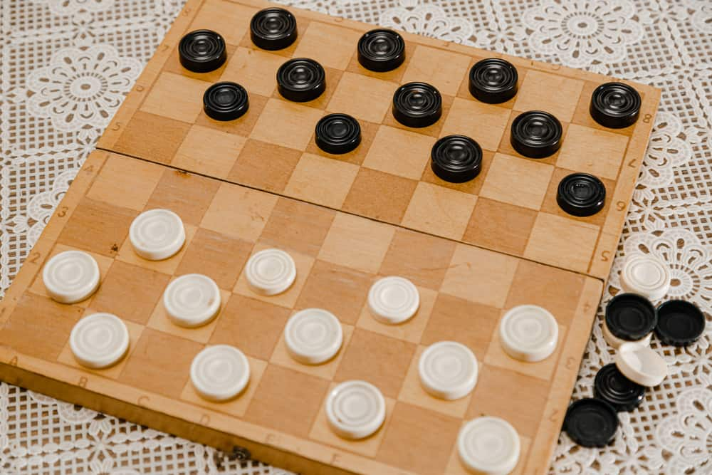 Brown wooden chessboard with classic checkers