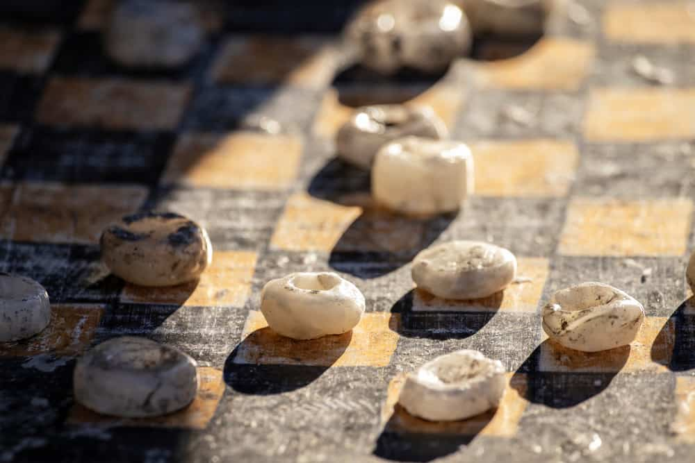 Old rough stone draughts close-up