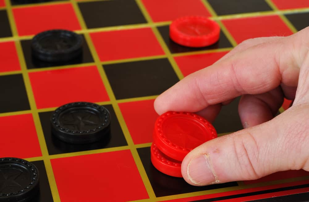 Playing checkers, making a king