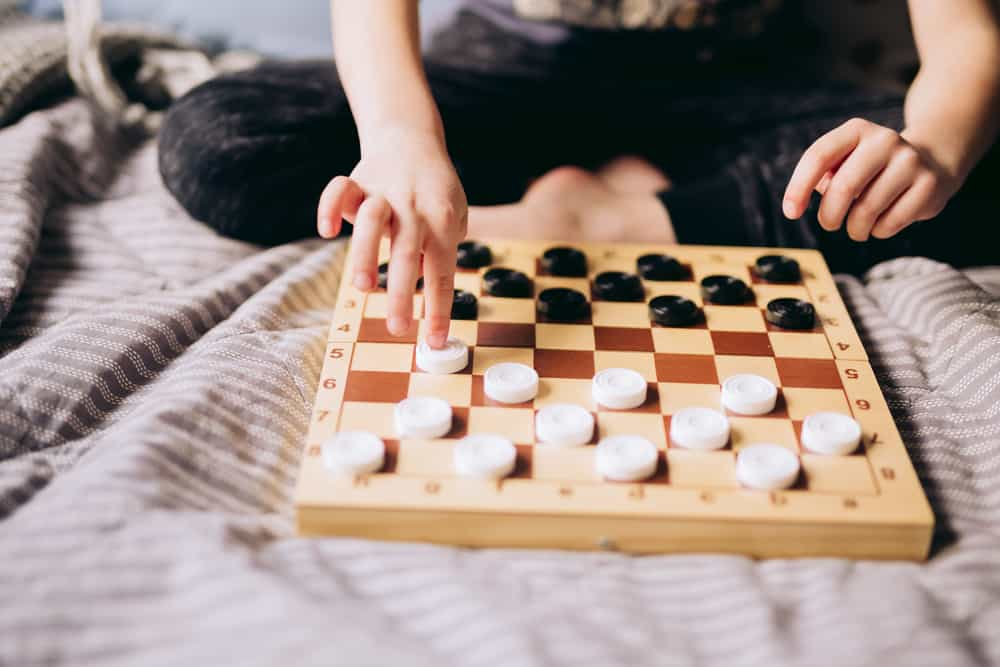 playing checkers alone