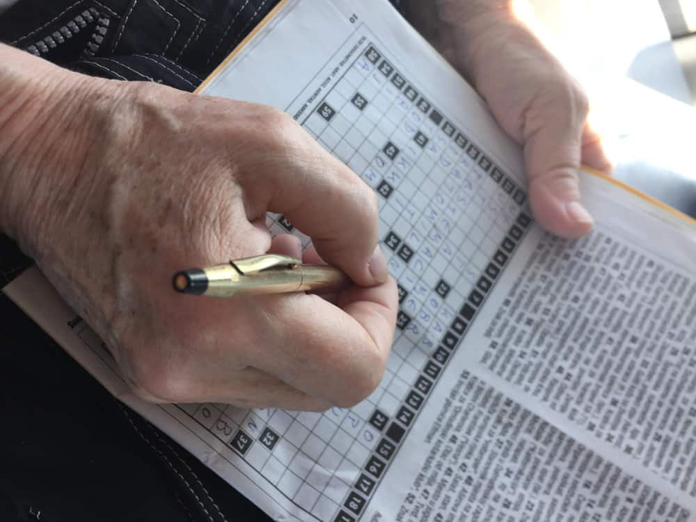 Person doing a crossword puzzle