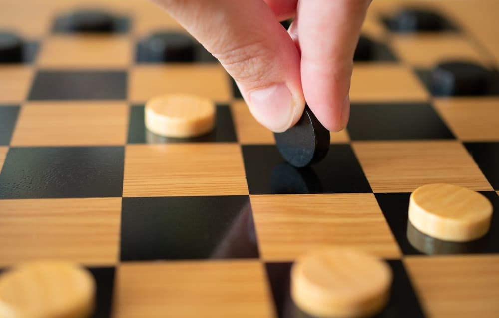 Playing checkers and making a move