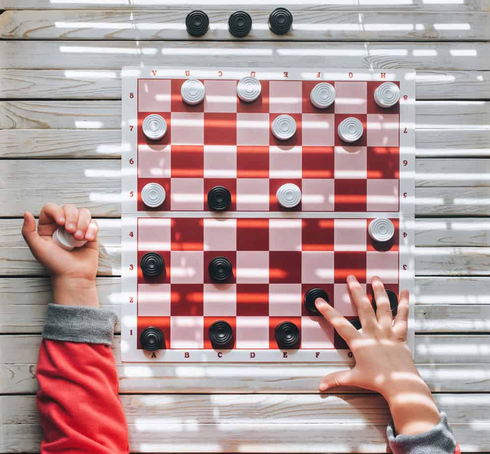 hands on a checkerboard