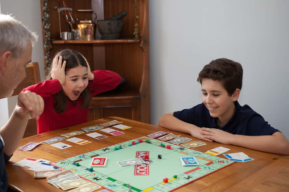 A family playing Monopoly 2