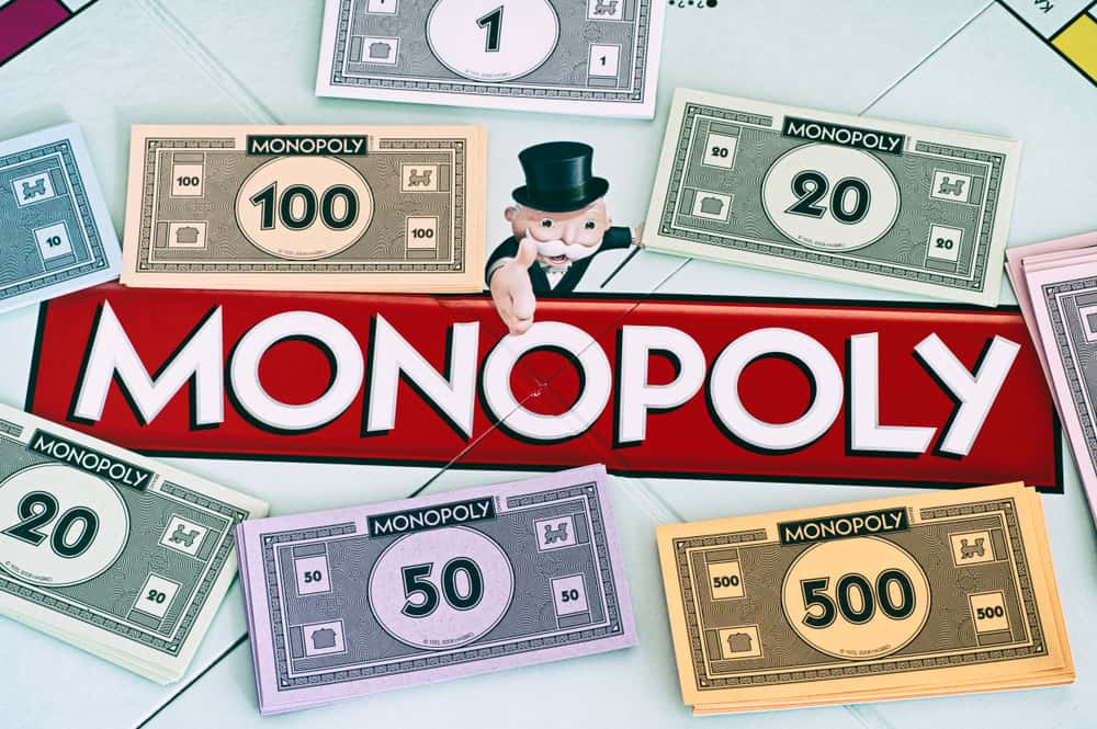 Center of Monopoly gameboard with money packs