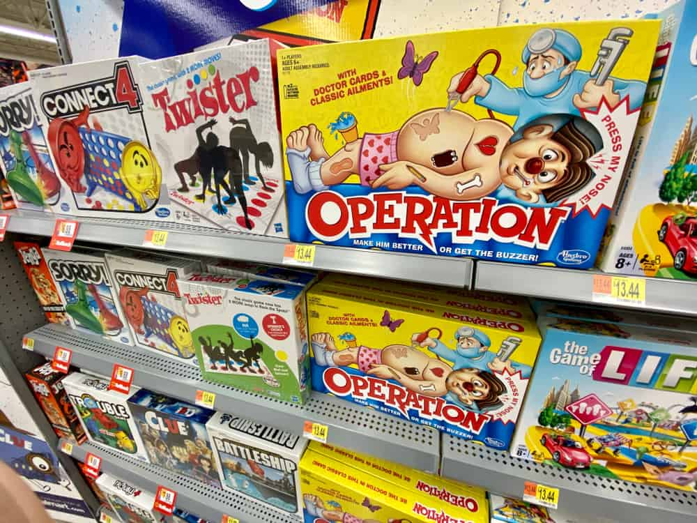 Classic board games on a store shelf, Operation, Twister and connect 4 amongst others