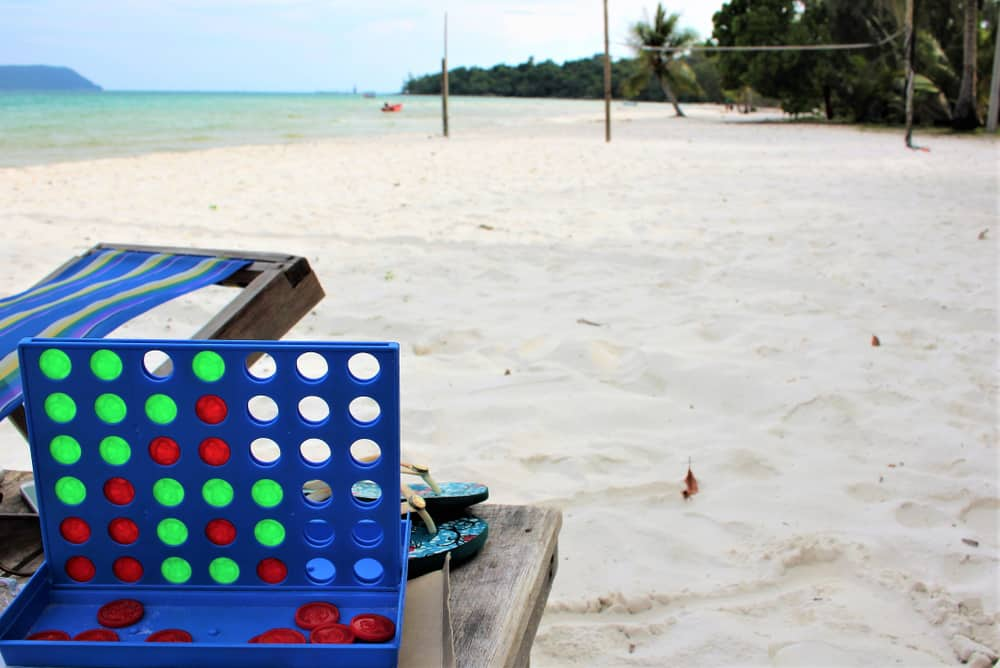Connect 4 Board Game Being Played On the Beach