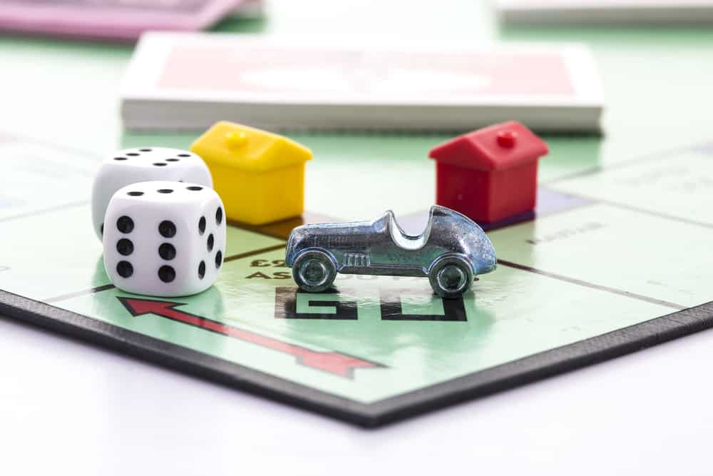 English Edition of Monopoly showing Pass Go