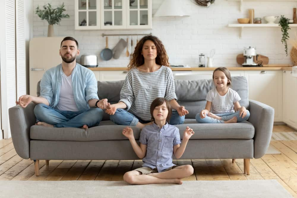 Family practicing yoga exercises, keeping it cool
