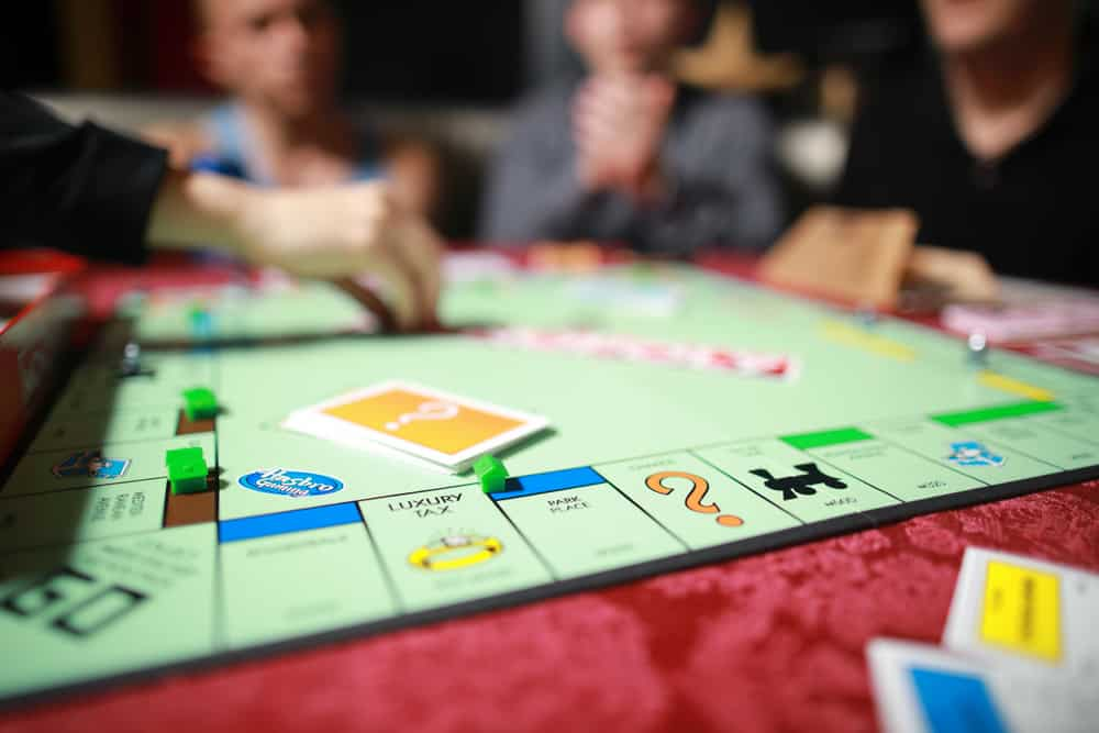 Group of people playing Monopoly board game