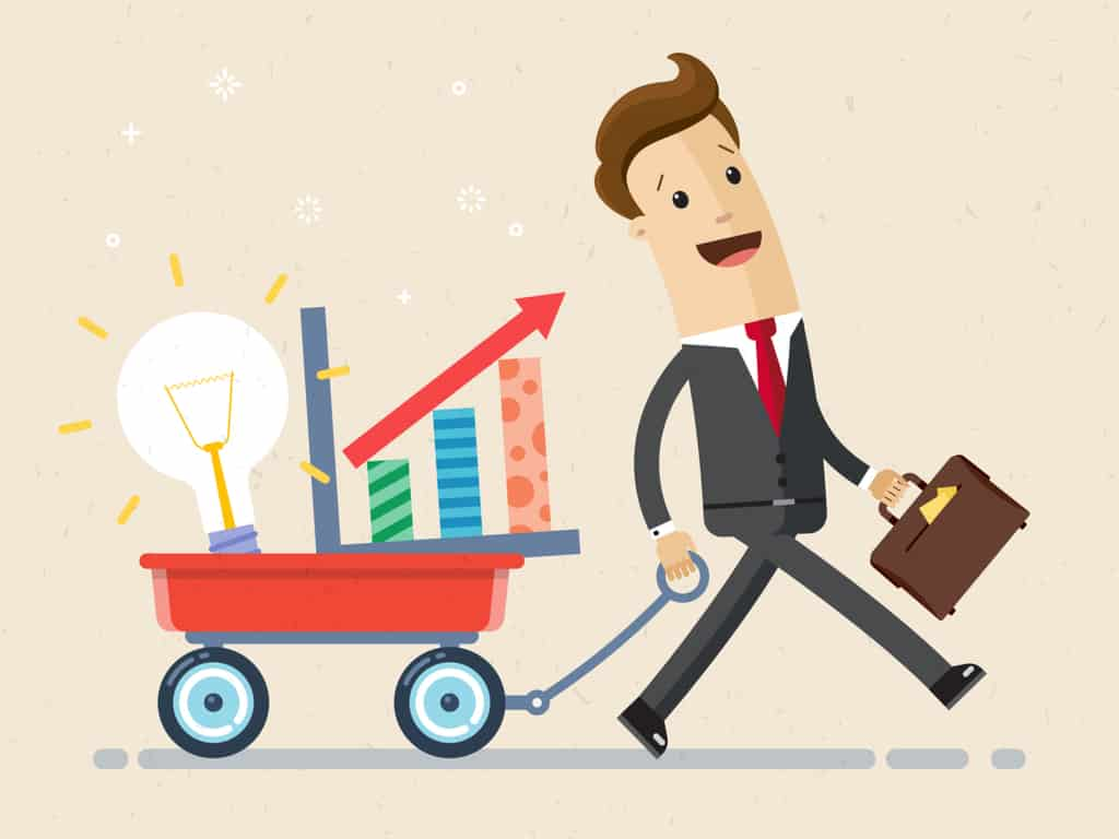 Happy businessman goes with a wheelbarrow. Business and finance concept
