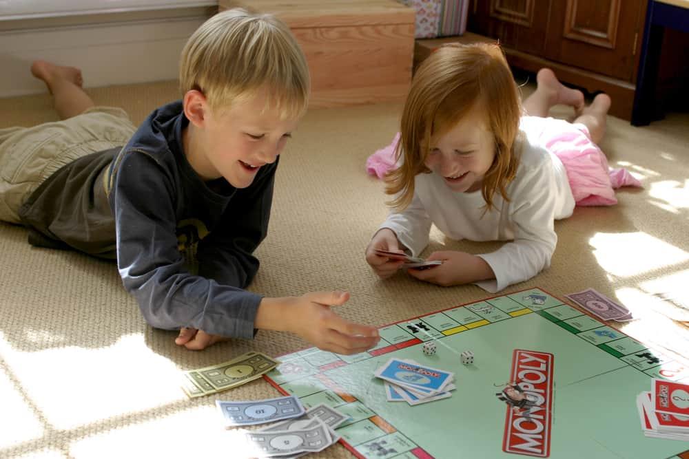 Kids having fun while playing Monopoly