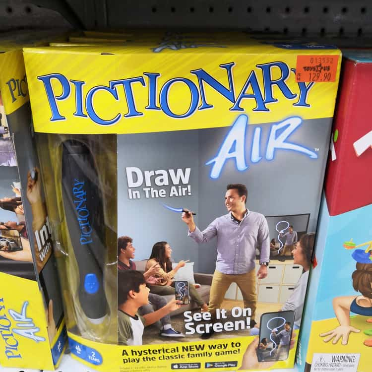 Pictionary game display for sale at Toys R Us in store shelf