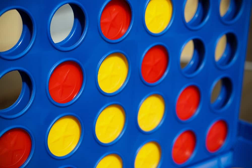 Puzzle game (Connect 4) with red and yellow counters