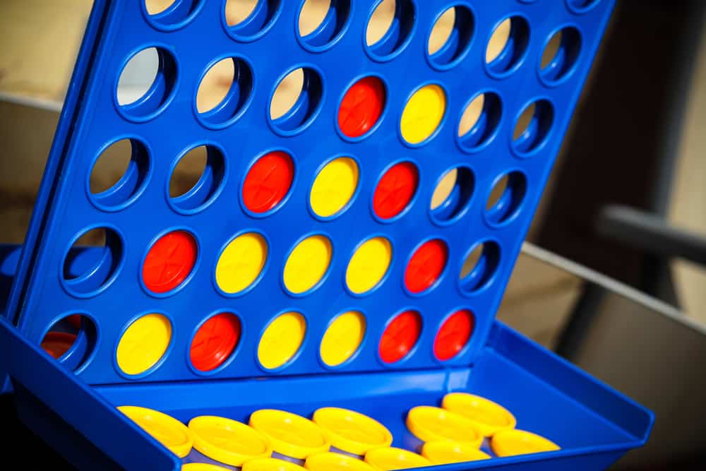 Puzzle game, Connect 4, with red and yellow discs