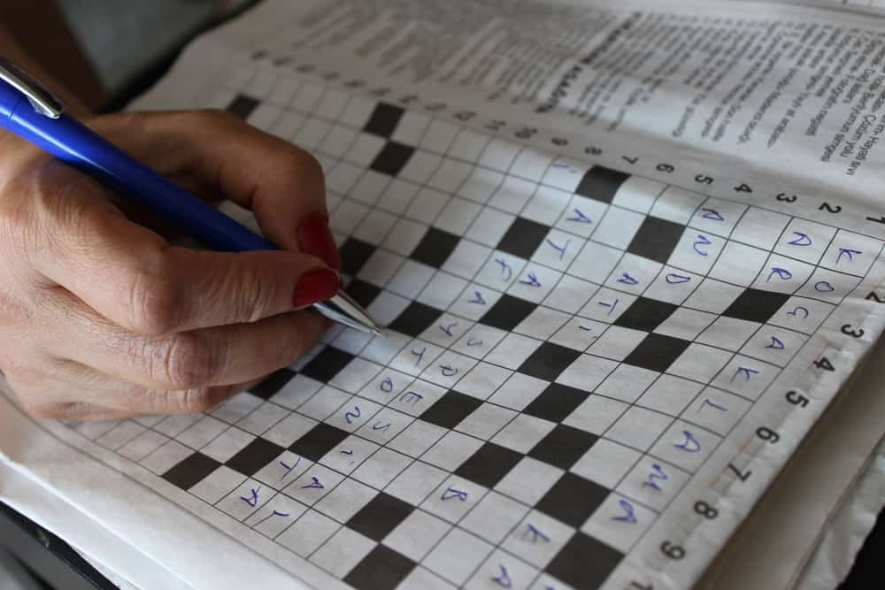 Someone is solving crossword puzzle for fun