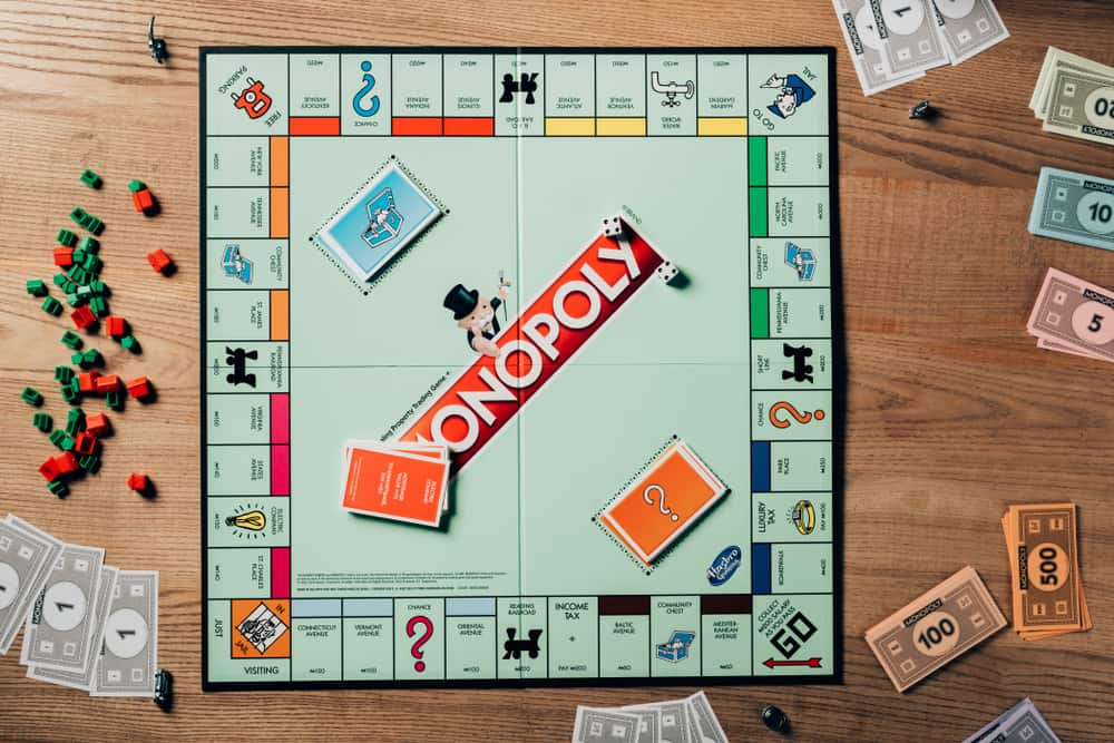 Top view of monopoly game on wooden table