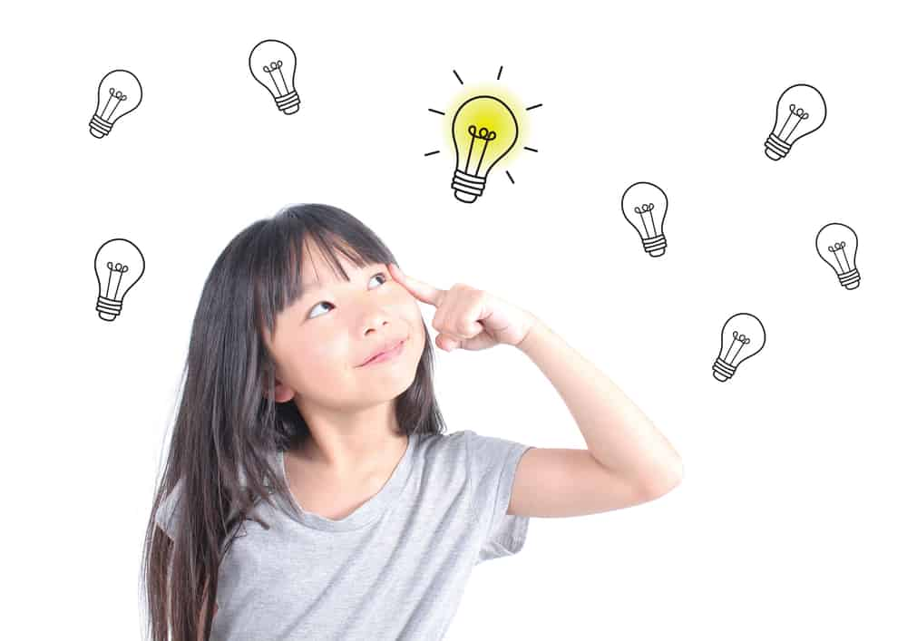 Young girl thinking. Idea and creativity concept