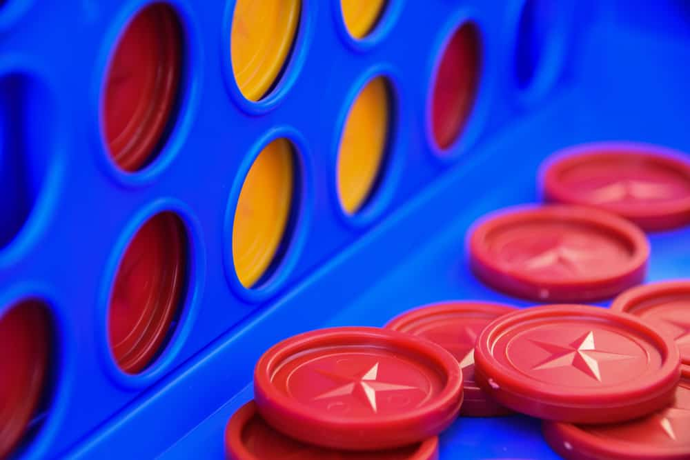 four in a row game with yellow and red discs