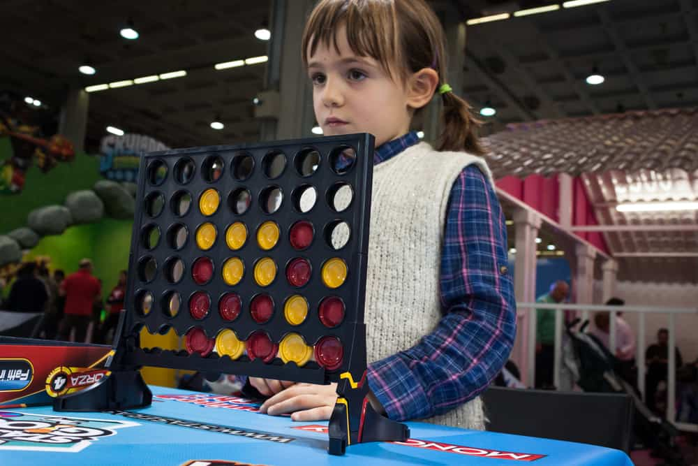 girl plays Connect Four