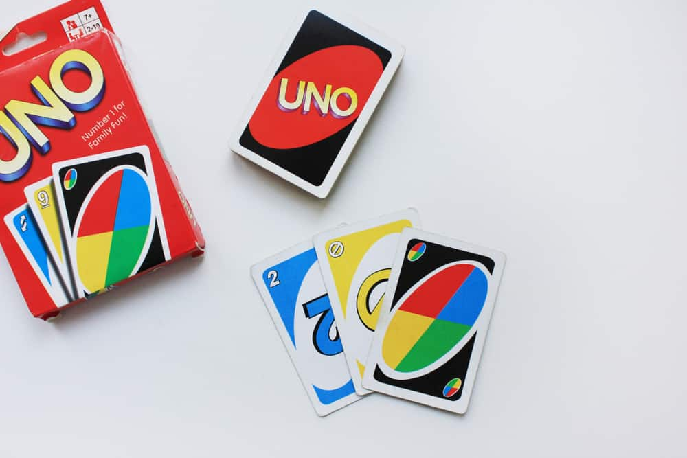 UNO card game with deck and playing cards on a table