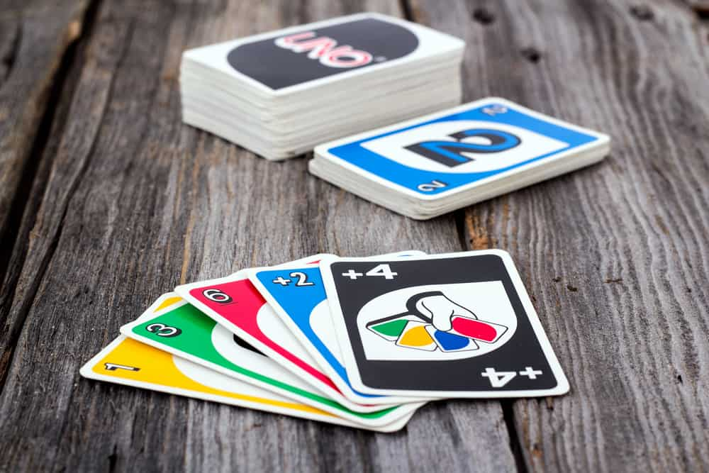 View of Uno card game on old wood table